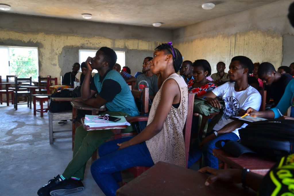 engineering students in Monrovia sit in a classroom listening during a workshop held by EWB-NL